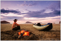 Kayak and campfire (benzi the expedition truck travel) Tags: people man weather dark season mexico fire evening day alone sitting outdoor smoke country scenic objects calm health northamerica bajacalifornia resting feeling bajacaliforniasur therapy oceans tranquile gender kayaks seaofcortez mex disasters gulfofcalifornia humanbehavior outdoorrecreation descriptive socialissues naturalresources environmentalissues ligui holidayorvacation lifestyleandleisure recreationalboats loretomarinesanctuary