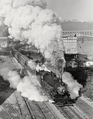 Ex-Grand Trunk Western USRA light 2-8-2 southbound on the Pittsburgh and Lake Erie on Pittburgh's Southside, with an excursion train bound for Brownsville, PA, 1974 (Ivan S. Abrams) Tags: blackandwhite newcastle pittsburgh butler bo ge prr ble conrail alco milw emd ple 2102 chessiesystem westmorelandcounty 4070 bessemerandlakeerie steamtours pittsburghandlakeerie ivansabrams eidenau steamlocomtives ustrainsfromthe1960sand1970s