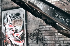 Below the Stairs (Georgie_grrl) Tags: friends streetart toronto ontario stairs graffiti alley expression under creative pentaxk1000 below colourful tagging graffitialley rikenon12828mm michelleandmichael hangingwiththedoublems shootingmainlyfilm