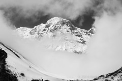 Annapurna in the Clouds (Andrew Stelmach) Tags: nepal blackandwhite bw mountain mountains beautiful clouds landscape asia cloudy surreal himalaya annapurna sanctuary basecamp mountainlandscape annapurnabasecamp annapurnabasecamptrek annapurnasanctuary annapurnabasecamptrail