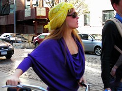 yellow bonnet (omoo) Tags: newyorkcity red girl beautiful beauty sunglasses bicycle yellow purple manhattan westvillage redhead redhair greenwichvillage meatpacking beautifulgirl yellowhat yellowbonnet veryquicksnap bicyclesnotpermittedonthehighline blurrybutshesbeautiful afterleavingthehighline prettybonnet