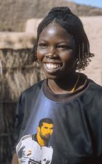 Mali : Mopti Region #11 (foto_morgana) Tags: africa portrait people girl smile african character afrika mali portret nikoncoolscan sourire analogphotography afrique glimlach teenagegirl persoonlijkheid karakter analogefotografie vuescan nomodelrelease caractre kroeshaar afrotexturedhair photographieanalogue editorialonly