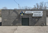 Unobstructed view of a cinderblock hardware store. (Tim Kiser) Tags: 2016 20160327 capitalregion eatoncounty eatoncountymichigan eatonrapids eatonrapidsmichigan img1555 lansingmetropolitanarea march march2016 michigan pettit pettithardware allcaps backdoor backentrance backside backsideofabuilding centralmichigan cinderblockbuilding cinderblockmasonry cinderblockwall cinderblocks concreteblockbuilding concreteblockwall concreteblocks crackedpavement customerparking customerparkingonly downtown downtowneatonrapids electricline gasmeter midmichigan noonsun noonsunlight overheadelectricline overheadpowerline paved pavement petticoat petticoatlogo powerline reardoor rearentrance shadows southmichigan southcentralmichigan southernmichigan stencillettering sunny uppercaseletters womanillustration womanlogo womanwearingapetticoat womanwithapetticoat unitedstates
