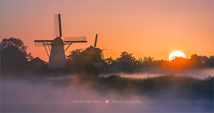 Sunrise Ten Boer - Netherlands (~ Floydian ~ ) Tags: henkmeijer photography floydian tenboer groningen netherlands holland bovenrijge widdemeuln damsterdiep windmill windmills sawmill classic dutch scenery sunrise dawn morning fog mist landscape landscapes canon canoneos1dsmarkiii