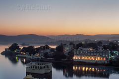 India, Rajasthan, Lake Pichola and the City Palace hotel (Cyrille Gibot) Tags: sunset sky india lake color colour reflection horizontal architecture outdoors hotel dusk indian palace luxury rajasthan udaipur citypalace picholalake