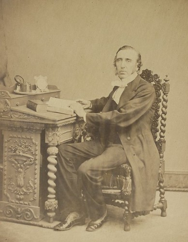 Unidentified man seated at writing desk