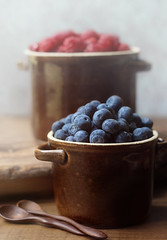 summer fruit (..Ania.) Tags: stilllife brown fruit vintage raspberries blueberries crocks woodenspoons