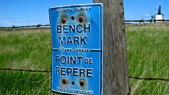 Bench Mark (Forgotten Corner Creations) Tags: canada grass rust ottawa alberta barbedwire geocache weathered survey skyblue prarie fencepost geodetic