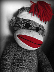 Nostalgia (Guitar Gal) Tags: blackandwhite childhood contrast toy monkey sock shadows nostalgia sockmonkey lonely noise stitched bold selectivecolor monos calcetínes