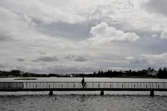 Across (andregnis) Tags: street lake silhouette clouds island iceland kid europe cloudy reykjavik controluce dadandkid