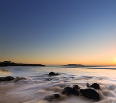 Early Morning Blue. (shakeyhands2212) Tags: longexposure blue sea beach silhouette yellow sunrise sand rocks waves bluesky 7d 1020 morningglow donabatebeach donabate lambayisland leefilters canoneos7d sigma102035 lee09ndhardgrad