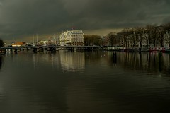 Amsterdam (Veyis Polat) Tags: cloud reflection netherlands hotel canal kanal amstel bulut yansma hollanda amasterdam suwater vision:outdoor=0835 vision:sky=0758 vision:clouds=0541 amstelkanal