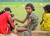 Raw and Pristine (thetravelingblock) Tags: girls red green art yellow rural children village fields henna mehndi