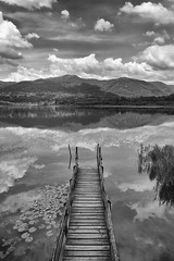 _DSC0185 (an Artist Without Art) Tags: cloud lake alps clouds lago pier still mirrored alpi brianza pontile lario monguzzo alserio larrygelmini