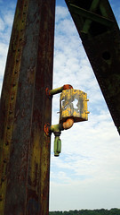 Chain of Rocks Bridge Lantern (Jae at Wits End) Tags: old bridge light sky texture lamp up yellow architecture rising peeling paint outdoor stlouis structure lookingup missouri infrastructure mississippiriver weathered lantern rise fixture cracked upwards chainofrocks