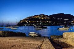 Port Andraxt, Majorca (CanonGirl101) Tags: light lighthouse water night boats boat lowlight harbour scene nightscene foreground majorca portandratx
