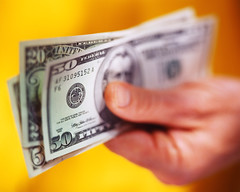 CB006499 (James Vornes) Tags: people money blur yellow photography 1 holding hands unitedstatesofamerica colorphotography government whites adults dollars selectivefocus papermoney culturalartifacts businessandcommerce