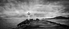 On the pier! (janetmeehan) Tags: street ireland sea blackandwhite howth dublin beach monochrome clouds canon landscape mono pier streetphotography atmosphere winterscene blancetnoir
