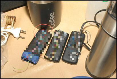 Three mobile phones adapted to work as timing devices. Found in Lapshyn's room