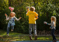 Trampoline Fun (Rick Smotherman) Tags: wood family flowers autumn trees stpeters nature leaves kids canon garden children outdoors 50mm morninglight backyard october brother 7d grandkids canon7d