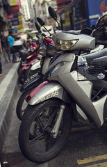 In a Row (Rapidrat) Tags: alex rural canon eos locals row east malaysia parked kuala clone moped effect far lumpur 6d align lined 24105mm alexandrou rapidrat