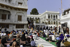 Devotees listening to religious songs in front of Akal Takht (Ashish A) Tags: india canon buildings religious temple asia action religion crowd staircase sikh devotee devotees amritsar digitalslr sikhism goldentemple canoncamera religioussymbol musicalperformance peoplesitting sittingpeople akaltakht goldentempleinamritsar canon650d religioussongs canont4i peoplewearingturbans peopleinsidegoldentemple peoplelisteningtosongs