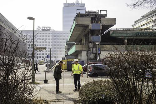Construction worker in front of Parkhaus Keibelstraße during demolition