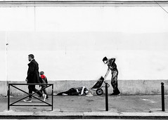 'Le marchand de sable' - 'The sandman' by Levalet (DeGust) Tags: poverty street red portrait people blackandwhite bw streetart man paris france color rouge graffiti blackwhite kid nikon europe child noiretblanc streetphotography social nb misery fatherandson enfant personnes couleur homme inscription noirblanc selectivecolor pauvreté pèreetfils littlestories misère scènederue 13earrondissement 13èmearrondissement d700 picswithsoul couleursélective ruedumoulindelapointe levalet sigma35mmf14dghsma