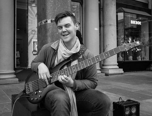 street blackandwhite musician man electric mono sitting guitar candid streetphotography diagonal busker anneworner