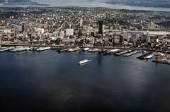 Waterfront, circa 1973 (Seattle Municipal Archives) Tags: seattlemunicipalarchives seattle waterfronts ferries piers wharves elliottbay pugetsound aerials lakewashington skylines 1970s