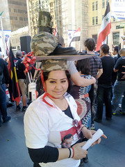 Protest hat (Roving I) Tags: vertical events politics protest hats syria demonstrations causes dissent helmets usembassy militaryboots