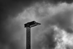 Mood Lighting (jasonroecker) Tags: sky blackandwhite bw monochrome clouds contrast nikon texas outdoor houston minimalism legacy f28 135mm oldglass d700