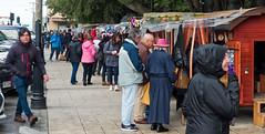 Sidewalk sales (LeftCoastKenny) Tags: chile patagonia day16 puntaarenas plazadearmasmuñozgamero vendors tourists trees
