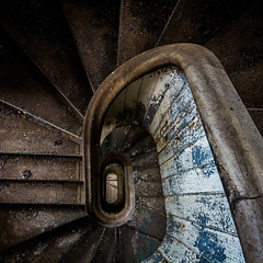 spinning on the spiral (Rodney Harvey) Tags: abandoned factory illinois spiral staircase stairs serpentine dizzy urban decay urbex