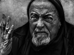 Gesture... (Ales Dusa) Tags: people outdoor oldman wrinkledman elderly old cap face portrait homeless canon5d gesture talk mantalking streetportrait hand beard emotion blackandwhite texture streetshot alesdusa closeupportrait closeup dramaticportrait strongcontrast