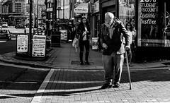 man (Chilanga Cement) Tags: fuji fujix100f x100t xseries x100s x100 x100f bw blackandwhite monochrome street streetphotography people men boy boys preston prestonstreetphotography pavement sidewalk