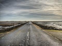the causeway to Lindisfarne (Holy Island) (neilalderney123) Tags: ©2017neilhoward olympus lindisfarne holyisland road england northumberland cloud