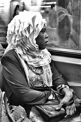 Daydreamer (cyndisuewho) Tags: nyc travel bw woman reflection monochrome subway streetphotography purse thinking handbag longing daydreaming clutching iphoneography uploaded:by=flickrmobile flickriosapp:filter=nofilter