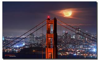 Moonrise over Golden Gate bridge and Transamerica Pyramid Center, San Francisco, CA