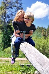 Seesaw Siblings (Allison Achauer) Tags: trees boy sky cloud love girl playground kids forest children fun happy log play sister brother rustic seesaw teeter totter siblings blonde
