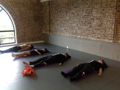 Kids in Savasana class in Aus