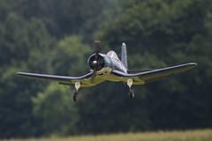 An F4U Corsair lands at Warbirds Over Delaware 2013 (Scott Alan McClurg) Tags: radio airplane army model fighter control aviation military wwii navy airshow event ww2 remote marines lightning airforce bomber rc trainer worldwartwo wod aricraft funfly warbirdsoverdelaware