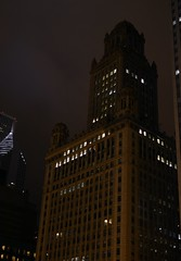 Looming Giant (earthtokristophor) Tags: windows light sky brown chicago color building tower stone architecture night clouds skyscraper 35mm dark evening illinois lowlight nikon downtown gloomy cloudy loop ominous gray historic 35eastwackerdrive jewelersbuilding d5100