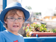 Portrait of little boy wearing blue hat (Carlos Ciudad - Stock Photography) Tags: blue light boy portrait españa luz hat fashion grancanaria azul 50mm glasses kid spain eyes europa europe child bokeh 5 retrato moda style olympus ojos desenfoque blonde estilo gafas years sombrero niño canaryislands zuiko mogan gettyimages islascanarias años rubio puertodemogan e520 gettyimagesspain cctrillastock