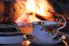 Fire and porcelain...[Explored 23rd January 2014] (Patrizia Ilaria Sechi) Tags: reflections fire book cozy fireplace sardinia warmth romantic porcelain enjoyment warmcolors boudelaire sweetmoments cozymoments firebokeh romanticatmosphere