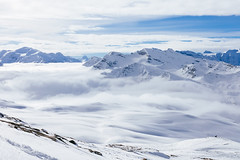 Above the Clouds (Jens van Bellen) Tags: blue winter sky cliff cloud mountain snow ski mountains alps cold film fog clouds canon french 50mm mark 14 sigma val ii f 5d 50 wintersport skier circular disere supply hoya valdisère polariser vsco