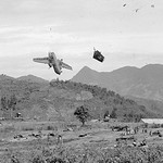 Vietnam War 1967 - Photo by Miromichi Mine  - Split seconds after a U.S. Caribou transport plane had been hit by American artillery, UPI thumbnail