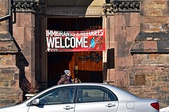 Welcome (AntyDiluvian) Tags: boston massachusetts backbay newburystreet church churchofthecovenant entrance doorway immigrants refugees sign