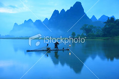 Fisherman-on-li-river (MPBHAIBO) Tags: china morning blue light mountain reflection tree lamp sunrise river landscape dawn liriver fishing fisherman guilin yangshuo hill cormorant    traditionalculture  chineseculture    mountainpeak fishingindustry asianculture   lightingequipment karstformation chineseethnicity  woodenraft  guangxiregion