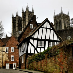 Lincoln Cathedral ...and an old wonky house (MickyFlick) Tags: history tourism architecture olympus tourists tudor architectural historic lincolnshire lincoln historical touristattraction crookedhouse lincolncathedral lincs michaelgate mickyflick